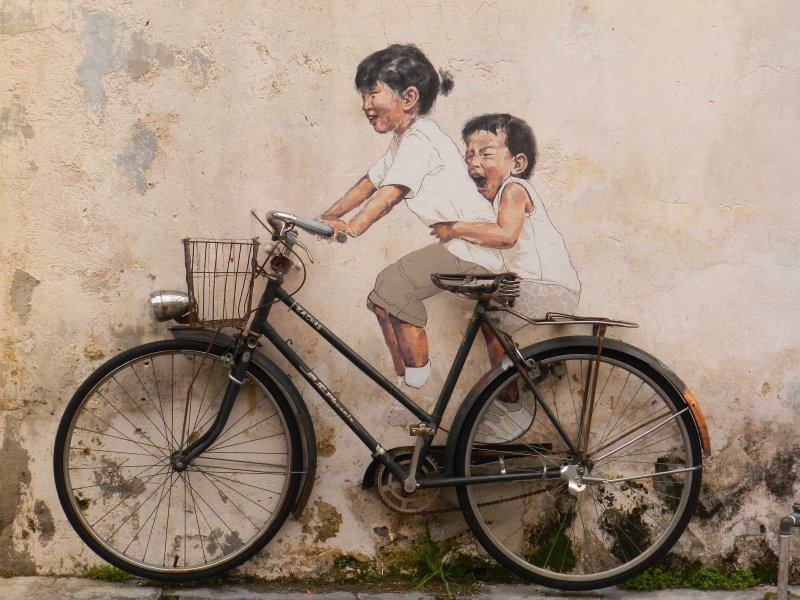 Image from: http://www.penang-traveltips.com/little-children-on-a-bicycle-mural.htm